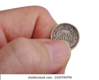 "Hand Holding A Silver Dime Pinched Between Two Fingers Revealing The Words ""One Dime"" Over Solid White Background"
