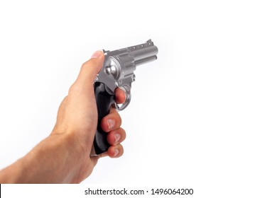 Hand holding a silver gun pulling the trigger, revolver in hand pointed away. Wild west handgun silver bullet pistol, dangerous shooter concept. Man pulling the trigger closeup isolated on white