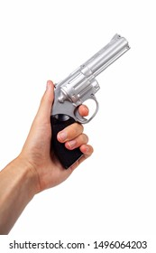 Hand holding up a silver revolver pulling the trigger, gun in hand facing up symbol. Wild west handgun, silver bullet pistol, dangerous weapon concept. Man firing a gun closeup isolated on white