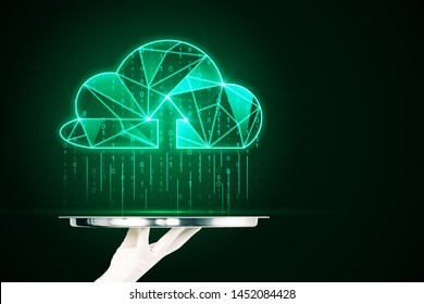 Hand holding silver tray with creative glowing green polygonal binary code cloud raining on dark background. Cloud computing and storage concept