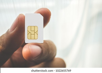Hand holding sim card, select focus, color effect