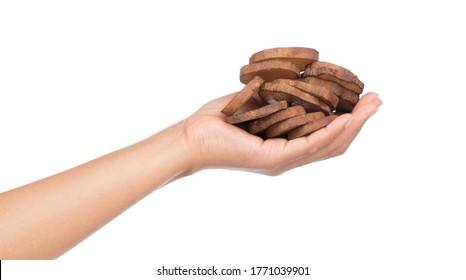 hand holding slice of fresh yam potato isolated on white background
