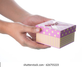 Hand holding small box for a gift isolated on white