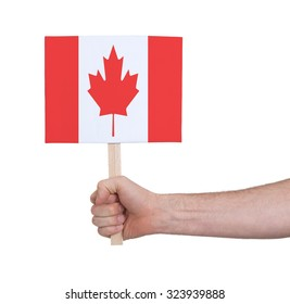 Hand holding small card, isolated on white - Flag of Canada