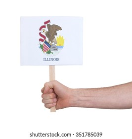 Hand holding small card, isolated on white - Flag of Illinois