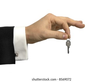 Hand holding a small key