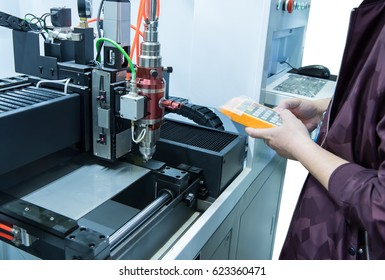 hand holding smart pannel to control Laser cutting of metal sheet, 3D rendering