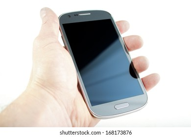 Hand holding a smart phone with blank screen , isolated on white