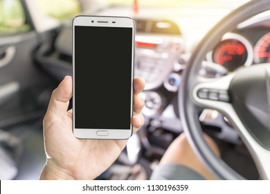 hand holding smart phone at car, clipping path.