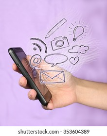 Hand holding smart phone, communication, office in your pocket in front of violet background