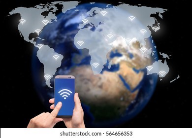 Hand holding smart phone on world map network and wireless communication network, abstract image visual, internet of things.Elements of this image furnished by NASA.