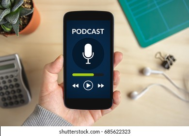 Hand holding smart phone with podcast concept on screen. All screen content is designed by me. Flat lay