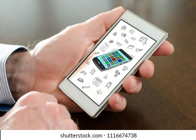 Hand holding a smartphone with apps concept