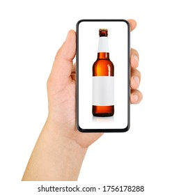 Hand holding smartphone with beer bottle on the screen isolated on white background. Online alcohol ordering.