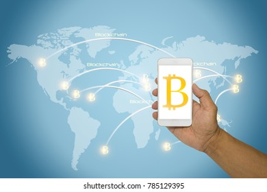 Hand holding smartphone to buy bitcoin and block chain on a white screen with connexions of transactions on a world map. Finance and crypto currency security concept