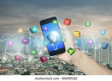 hand holding smartphone and concept technology social media network connection in city scape.