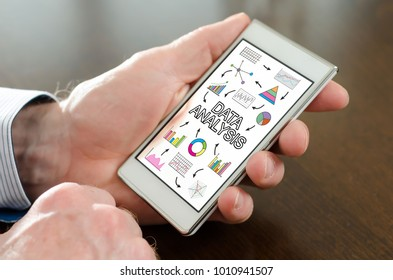 Hand holding a smartphone with data analysis concept