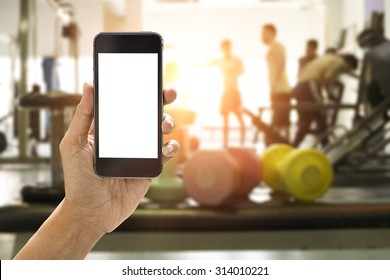 Hand holding smartphone device at gym background