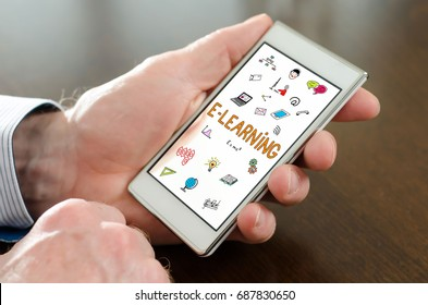 Hand holding a smartphone with e-learning concept
