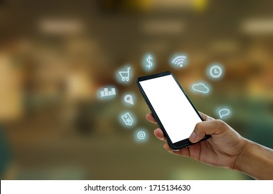 Hand holding smartphone with icons concept. Hand use smartphone online shopping Social network concept.