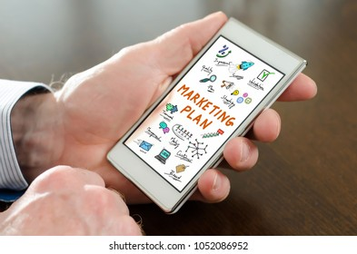 Hand holding a smartphone with marketing plan concept