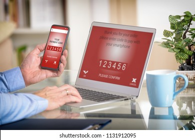 Hand holding smartphone over notebook, concept of e-commers and making mobile payment for online order