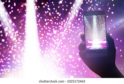 Hand holding smartphone records live music festival, Taking photo of concert on stage, live music festival, concert luxury party.