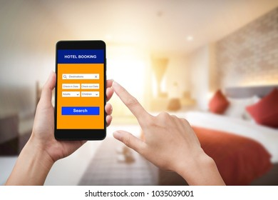 Hand holding smartphone with room reservation application.