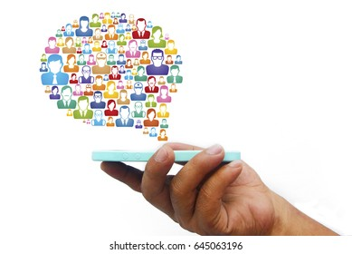 Hand holding smartphone with social media icon over white background