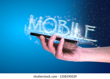"Hand holding smartphone with sparks, stars and text saying ""Mobile""."