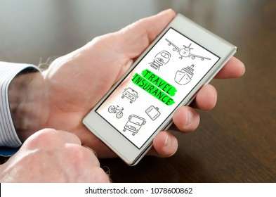 Hand holding a smartphone with travel insurance concept
