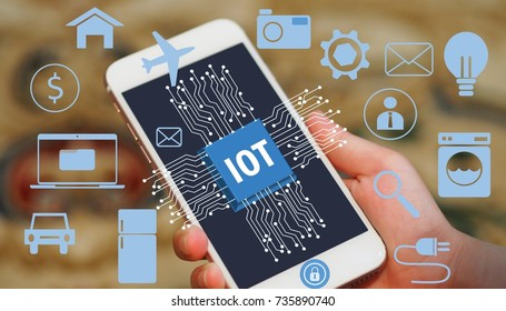 Hand holding a smartphone with a virtual icon floating around to display the concept of Internet of Things (IOT)