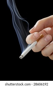 A Hand holding a smoking cigarette