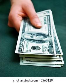 hand holding some money. Shallow DOF