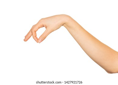 Hand holding something with forefinger and thumb