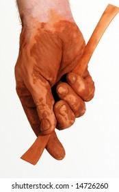 Hand holding a spatula