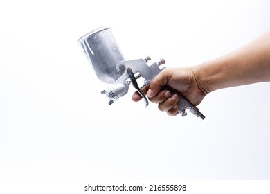 Hand is holding a spray gun HVLP high volume low pressure.