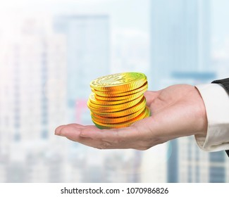 Hand holding stack of golden digital coin with question mark, concept of cryptocurrency, blockchain technology, bitcoin mining.