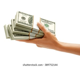 Hand holding stacks of dollars banknotes isolated on white background. Business concept