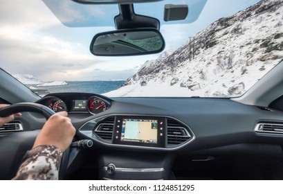 Hand holding steering wheel in luxury private car, Driving in rural road on winter season
