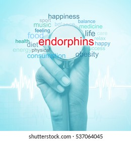 hand holding stethoscope with endorphins word. medical concept