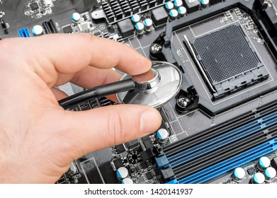 Hand holding stethoscope over motherboard. Diagnostic and repair computer concept.