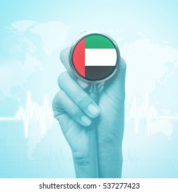 hand holding stethoscope with United Arab Emirates flag.