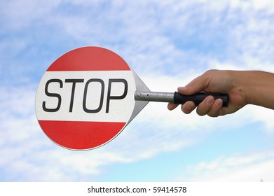 Hand holding stop sign