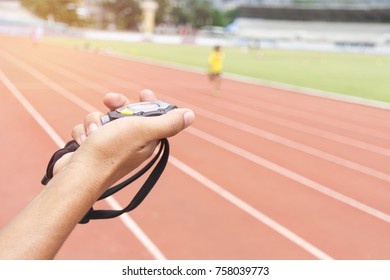 hand holding stopwatch digital on blur background a athletics track