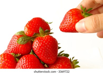 hand holding the strawberry