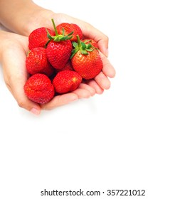 hand holding strawberry on white