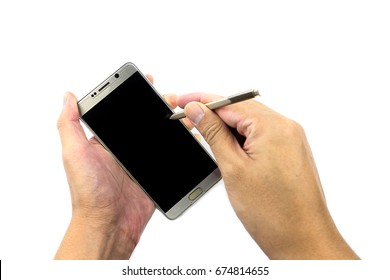 Hand holding a stylus pen and a smartphone on white background. Stylus pen is a small pen-shaped instrument that is used to input commands to a computer screen, mobile device or graphics tablet.