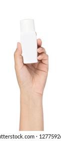 Hand holding sunscreen bottle isolated on white background.