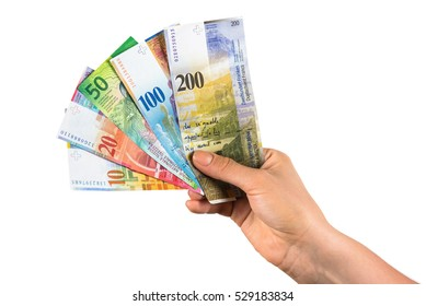 Hand holding swiss franc banknotes isolated on white background with clipping path